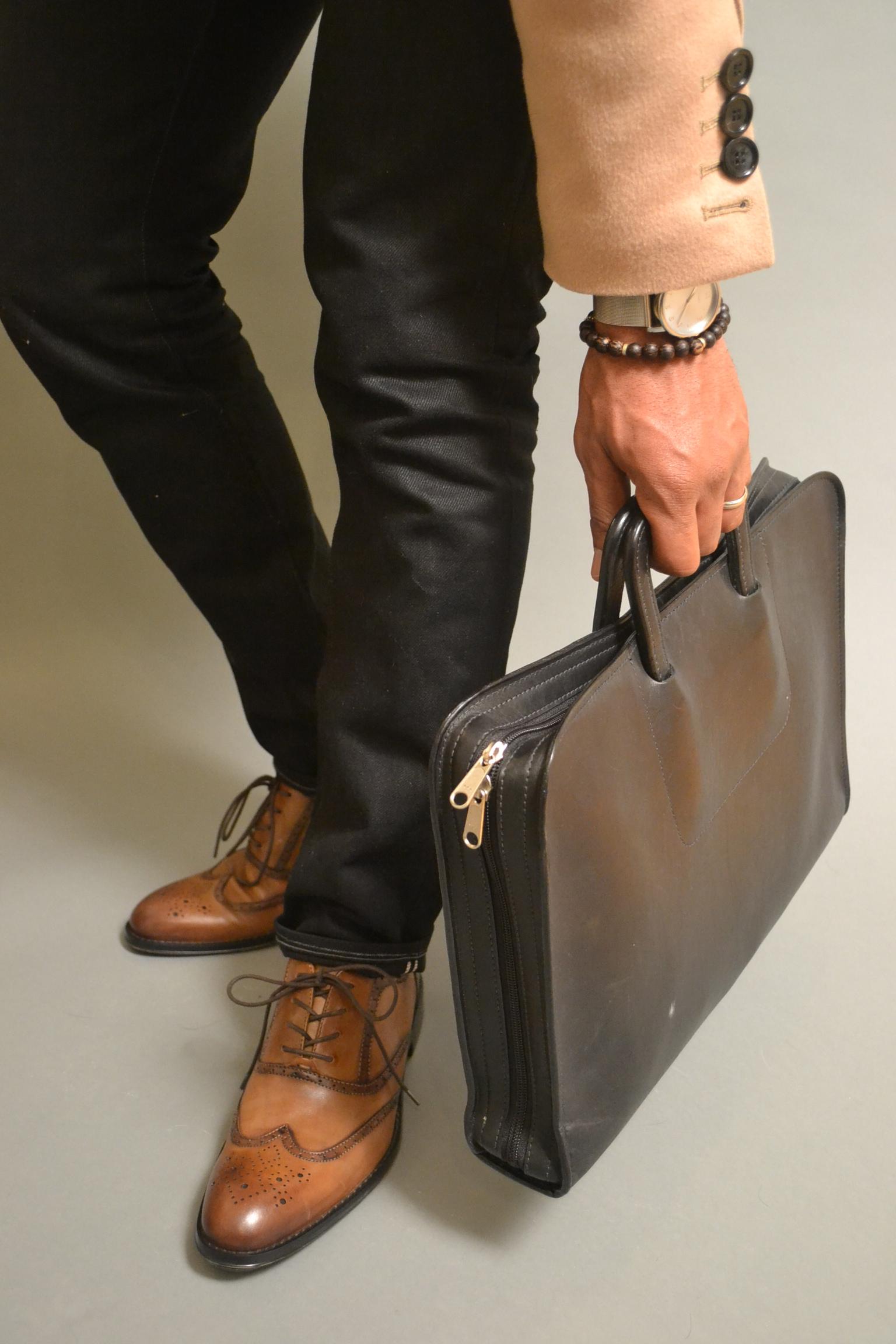 Sabir in Aston Grey Wingtips, 3x1 black jeans, tobox bracelet & korchmar briefcase