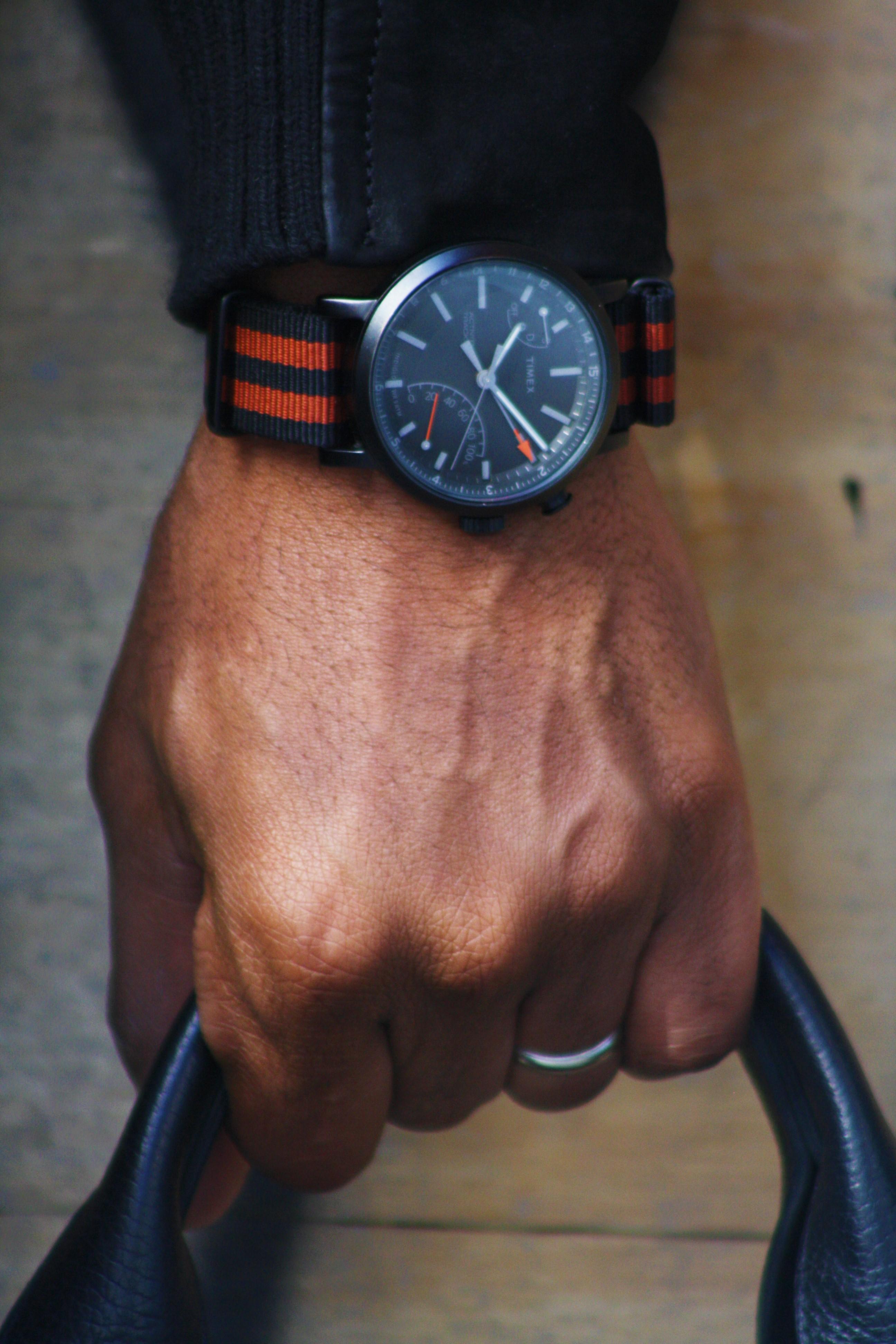 Sabir M. Peele of Men's Style Pro wearing Timberland Tenon Jacket & Black Boots with Grungy Gentleman Varsity Joggers w/ Mitchell & Ness Collaboration Hat & Time Metropolitan+ Watc