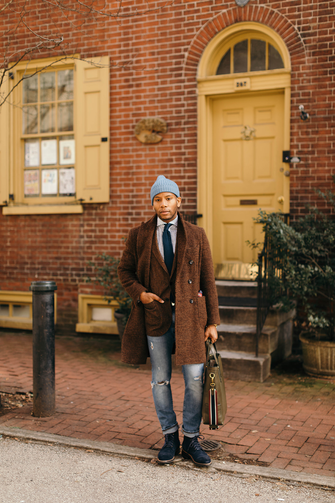 Sabir M. Peele in 0909 Italia Brown double breasted topcoat via ModaMatters & Thursday Boot Co Suede Boots